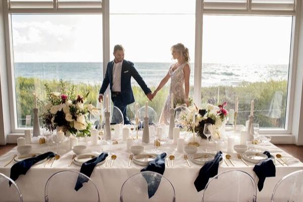 Coast Port beach wedding with stunning ocean view backdrop