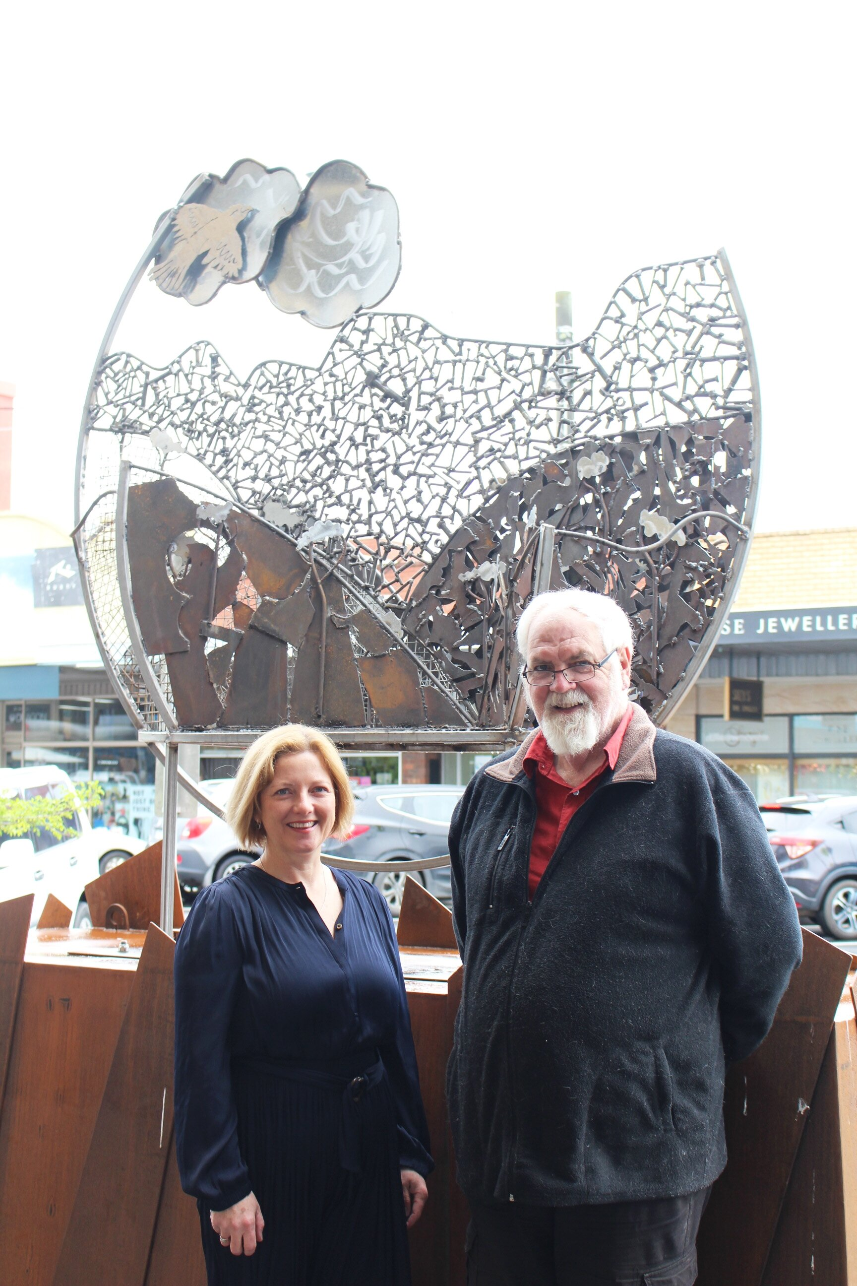 Mayor Mikaela Power and sculptor Laurie Collins in front of Laurie's inaugural Smith Street sculpture.
