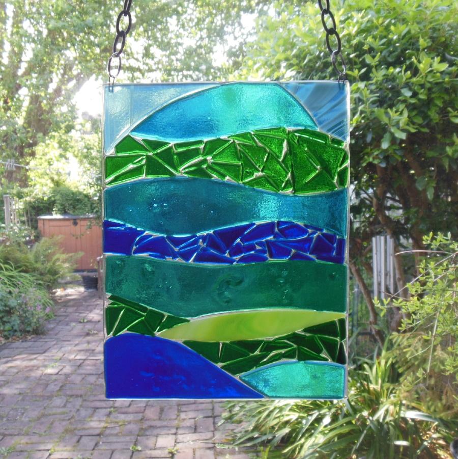 Blue-green fused glass seascape
