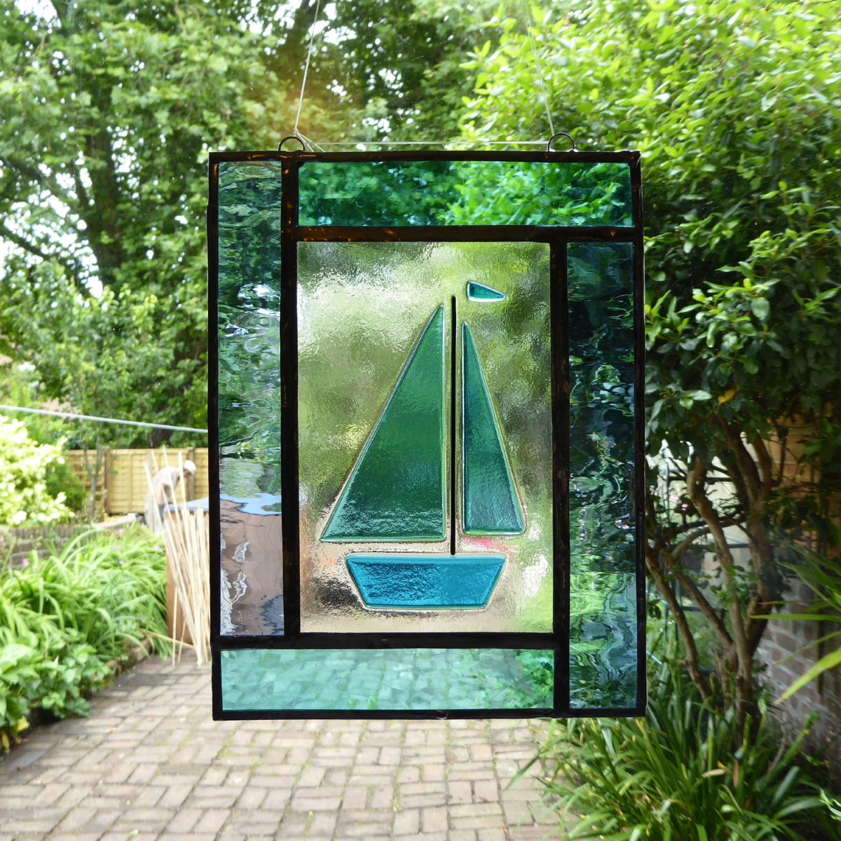 Blue sailboat window panel