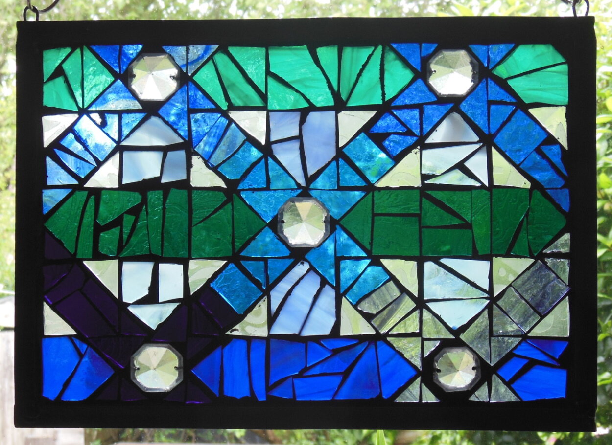 eva-glass-design-blue-green-geometric-stained-glass-mosaic.jpg