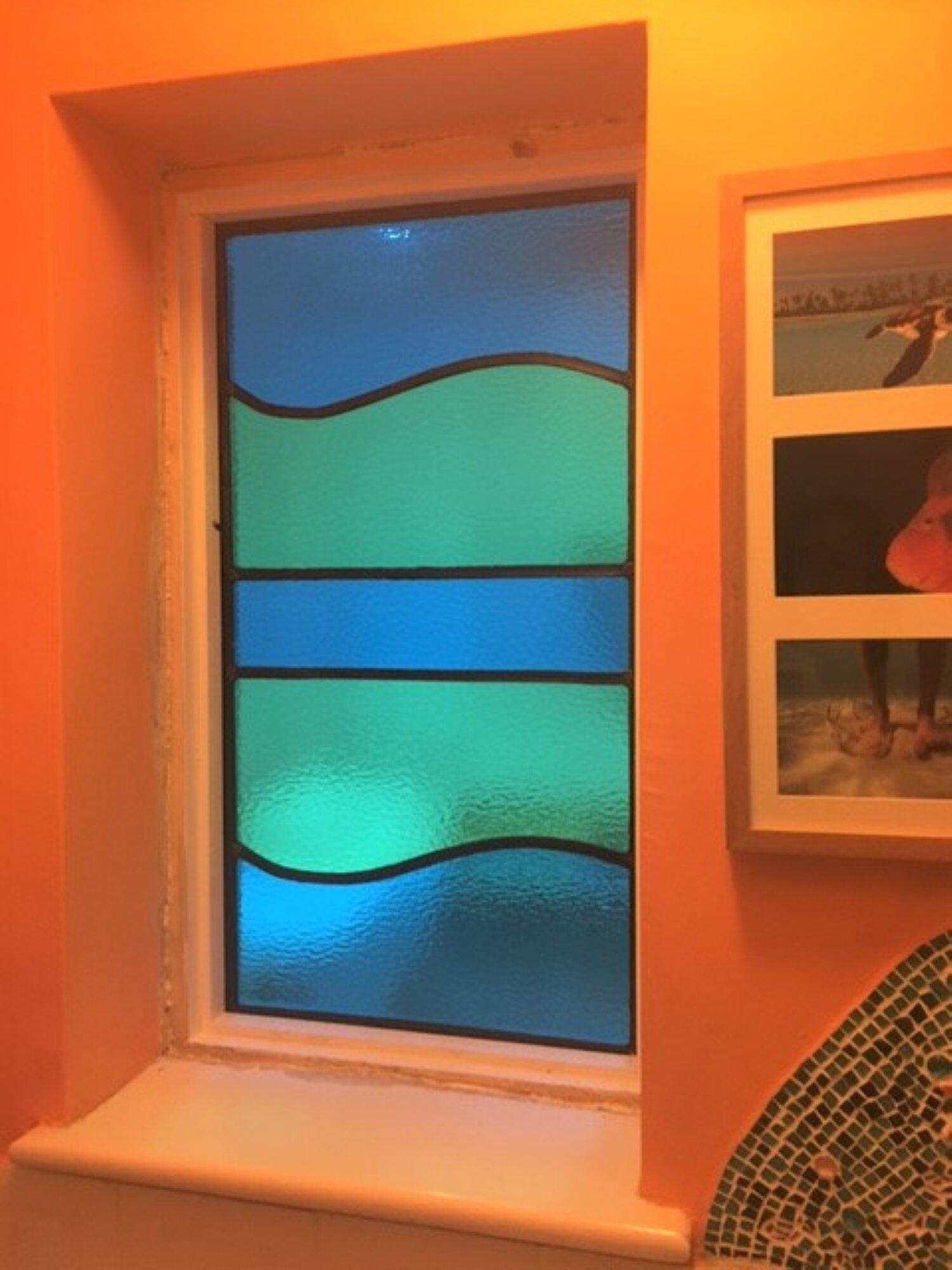 eva-glass-design-blue-green-stained-glass-window.jpg