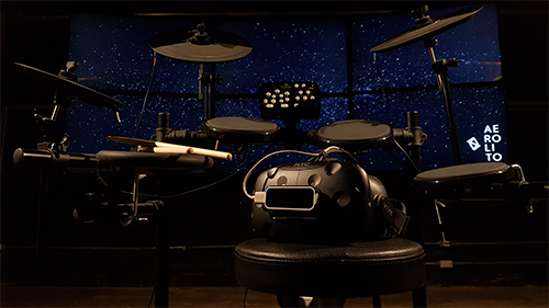 equipment setup with an electronic drum kit and the vr headset