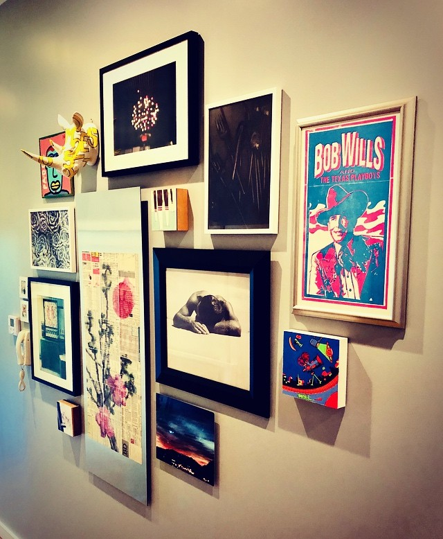 """Enjoy the Ride"" is our recent installation that blends an eclectic selection of mementos and artworks. The more eclectic the collection the more interesting it becomes! Do you want to create a wall with its own personality? We'd love to help! www.farberartservices.com #enjoytheride #farberartservices #arttoinspiration #picturehanging #artinstallation #homecuration #wallswithpersonality"