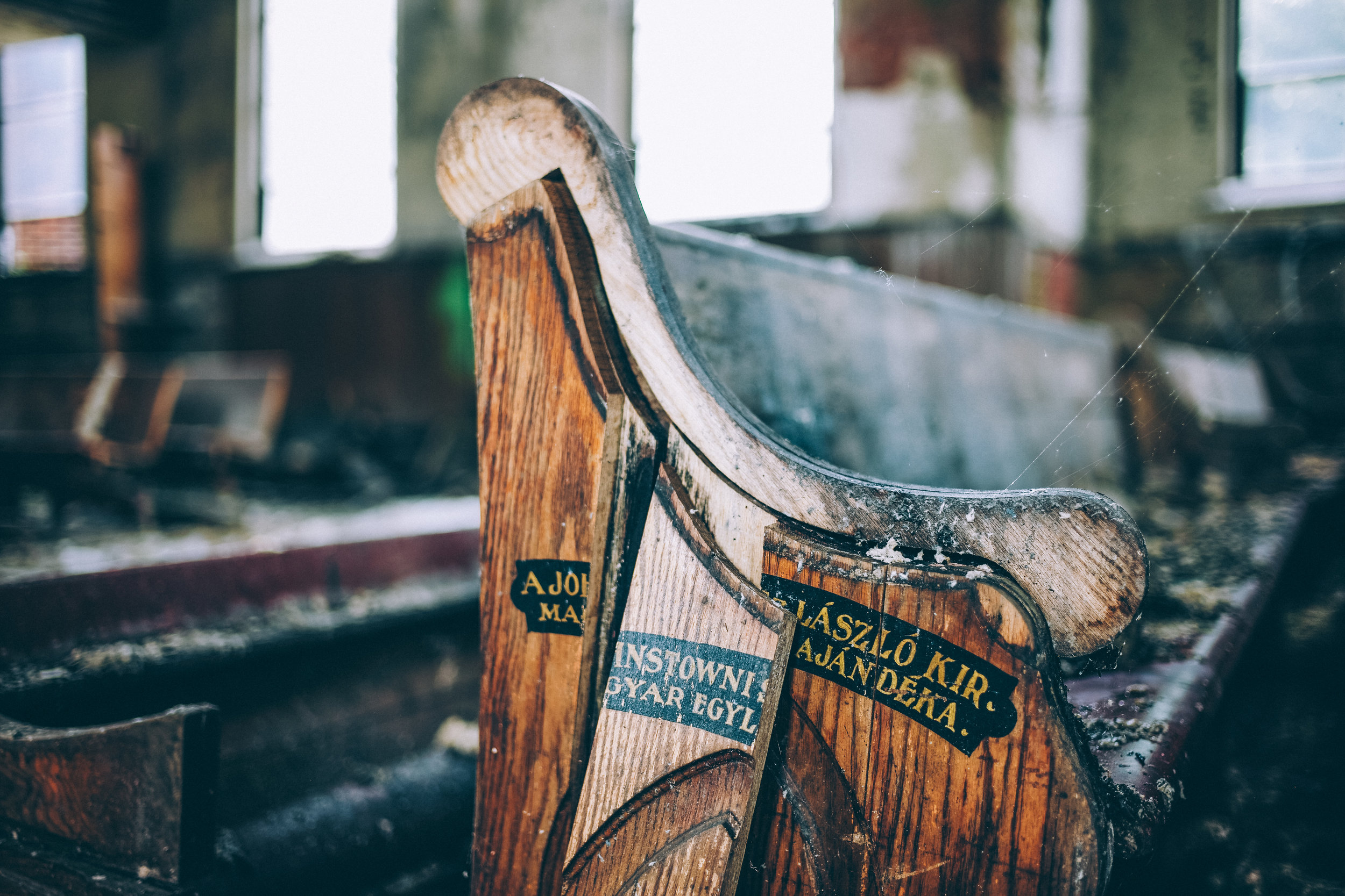 pictured above: Hungarian lettering painted on the church pews.
