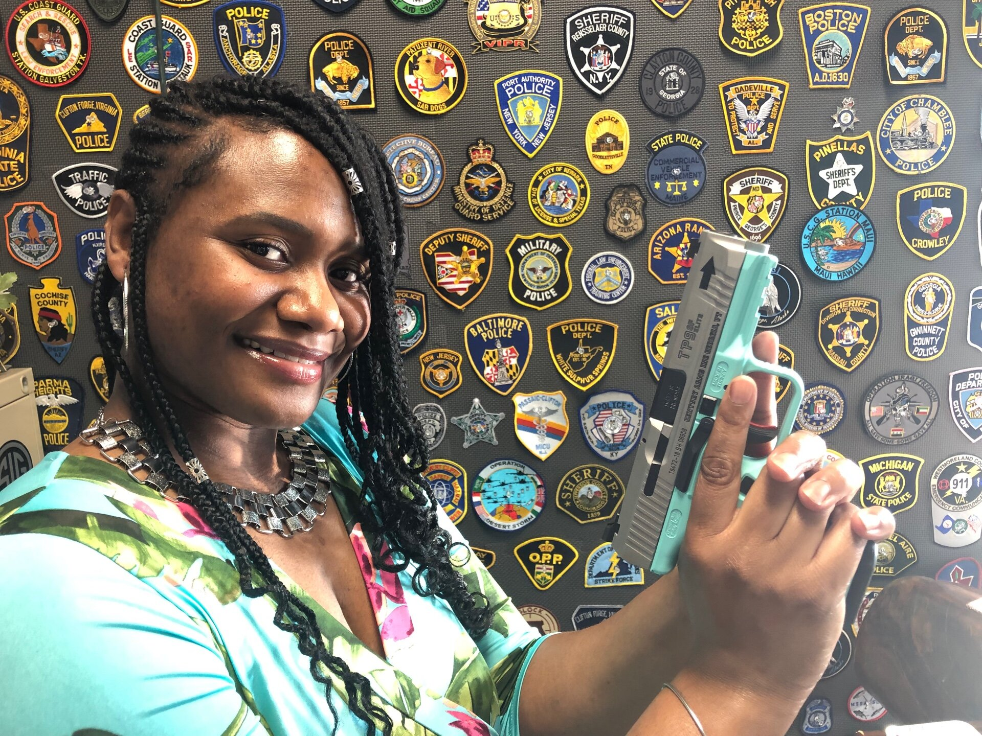 Another very satisfied customer with a color-coordinated pistol that she shot very well.