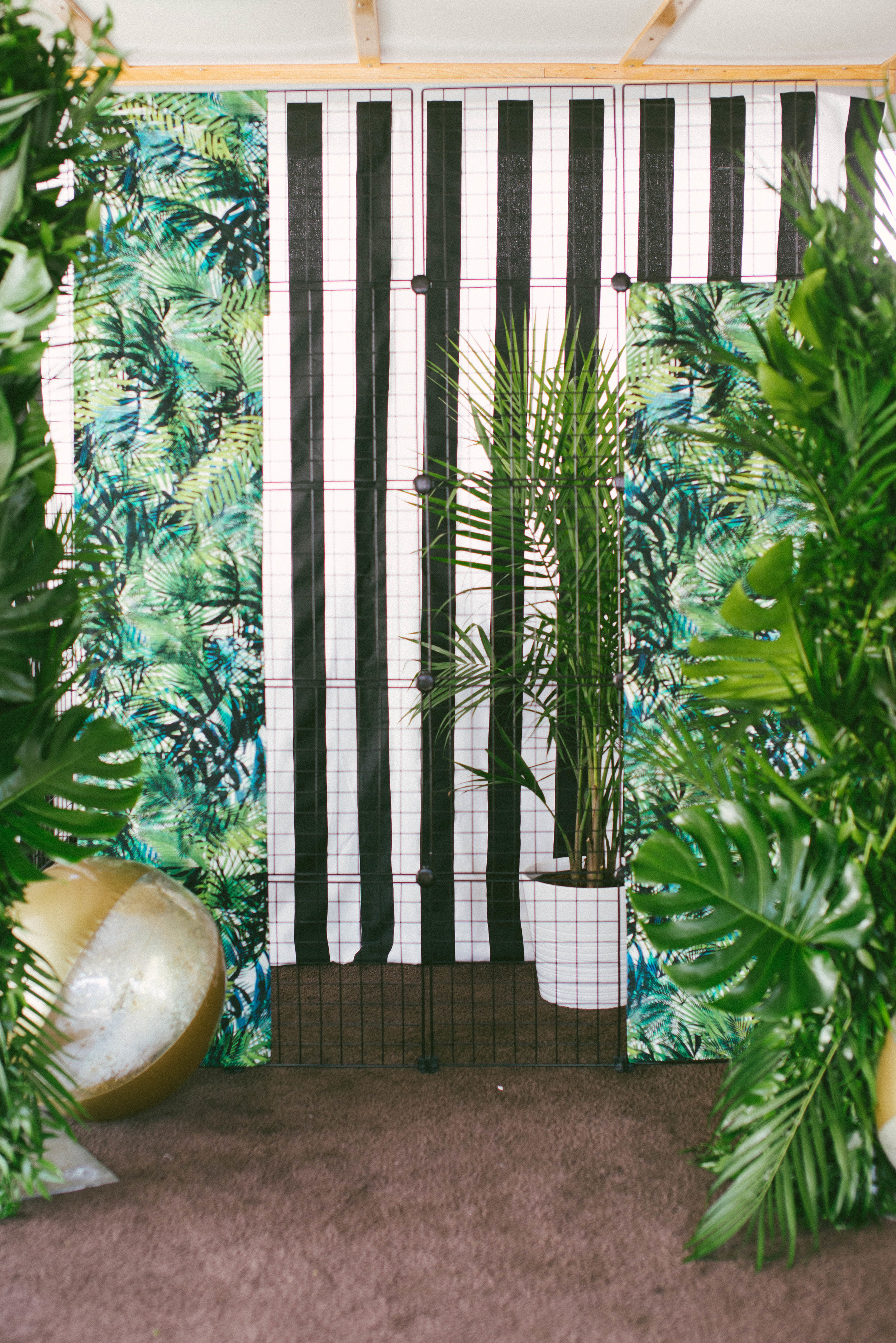 Accents included flamingos, beach balls, and of course pineapples. Large palm leaf installations created the perfect canopy for guests to take a photo op. -