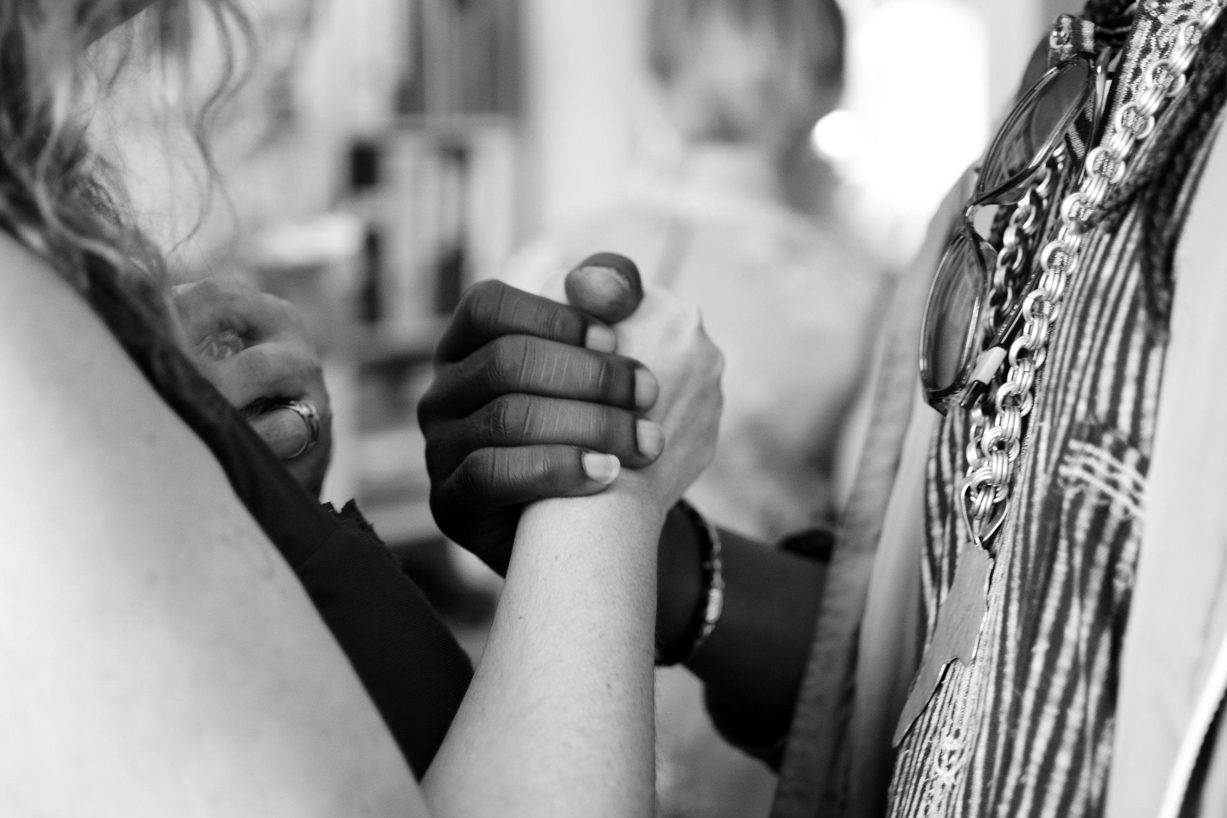 Hand shake between two people.