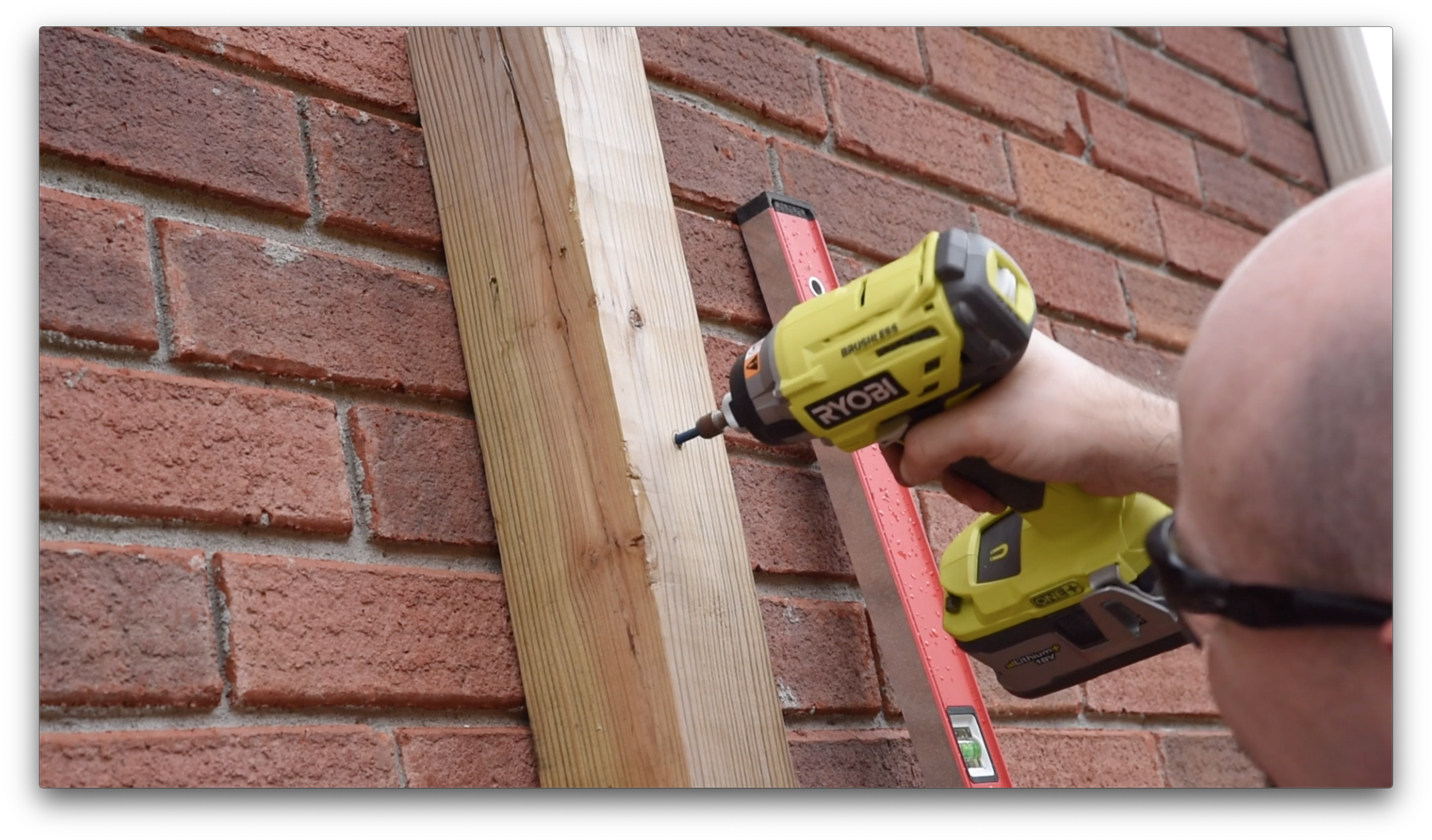 """Securing the fence post to my brick wall with 5"""" TAPCONs"""