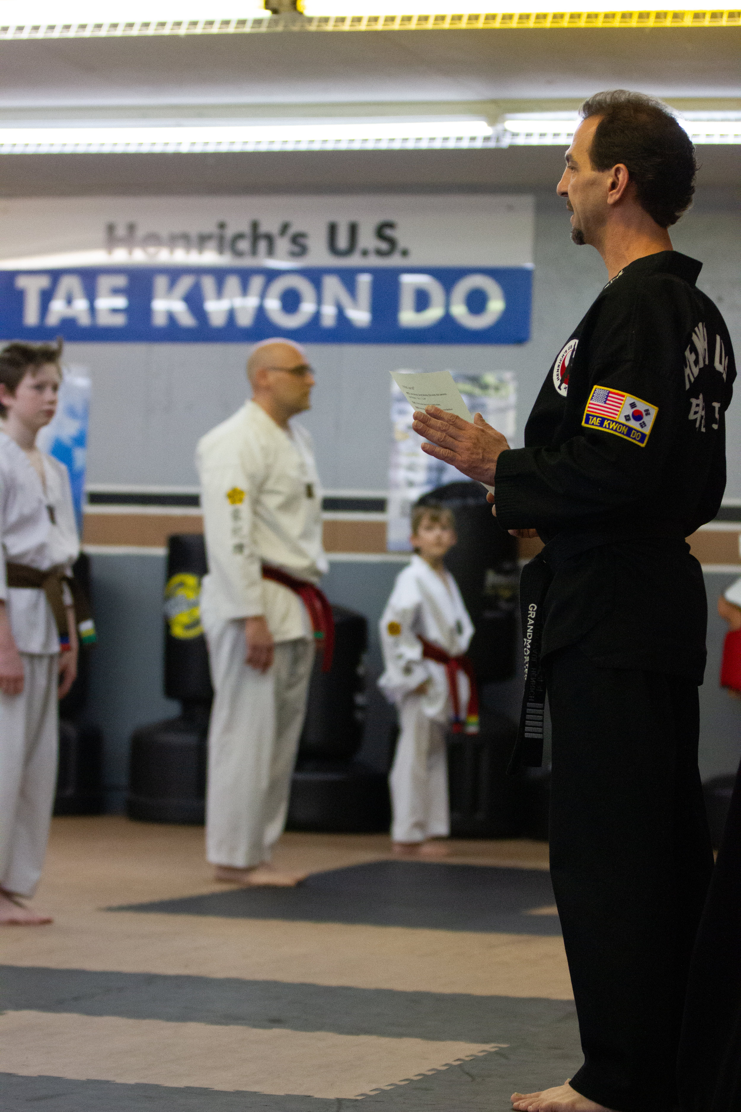 Master Paul Henrich addressing students at a belt-advancement test.