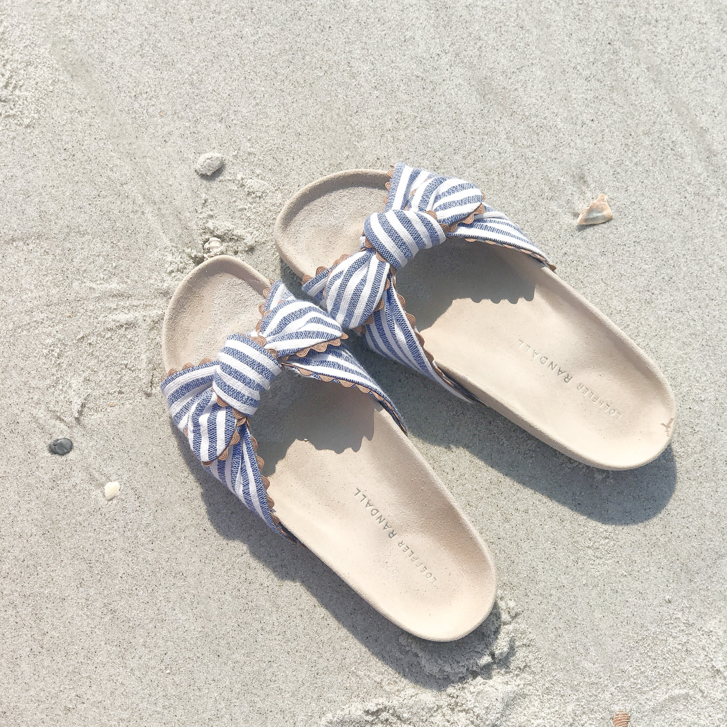 LOVE these    stripe pool beach    shoes which can be found      here      and    here   !