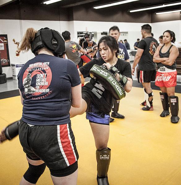 Muay_Thai_two_women_kicking2.jpg