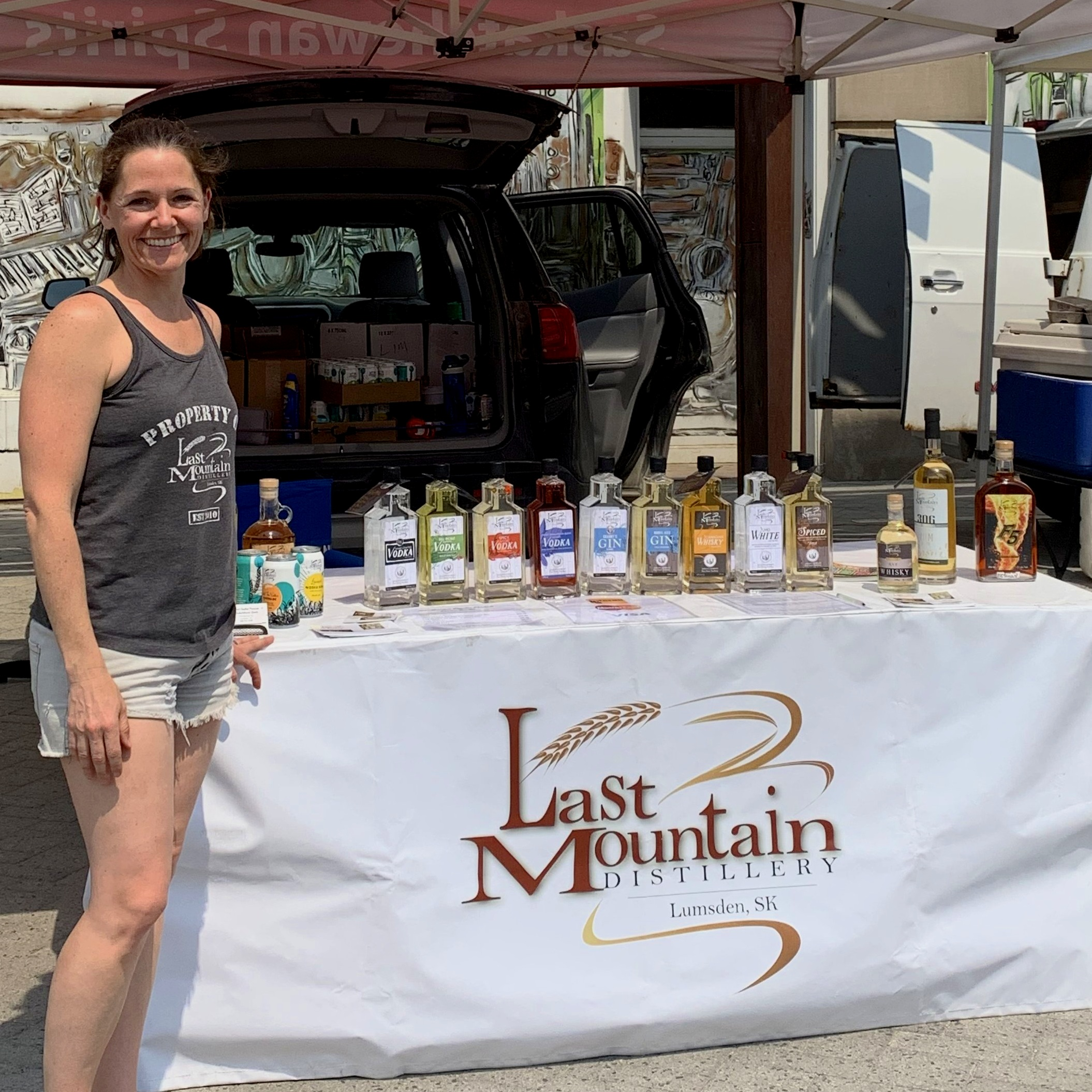 Meredith at LMD's Farmer's Market Stand
