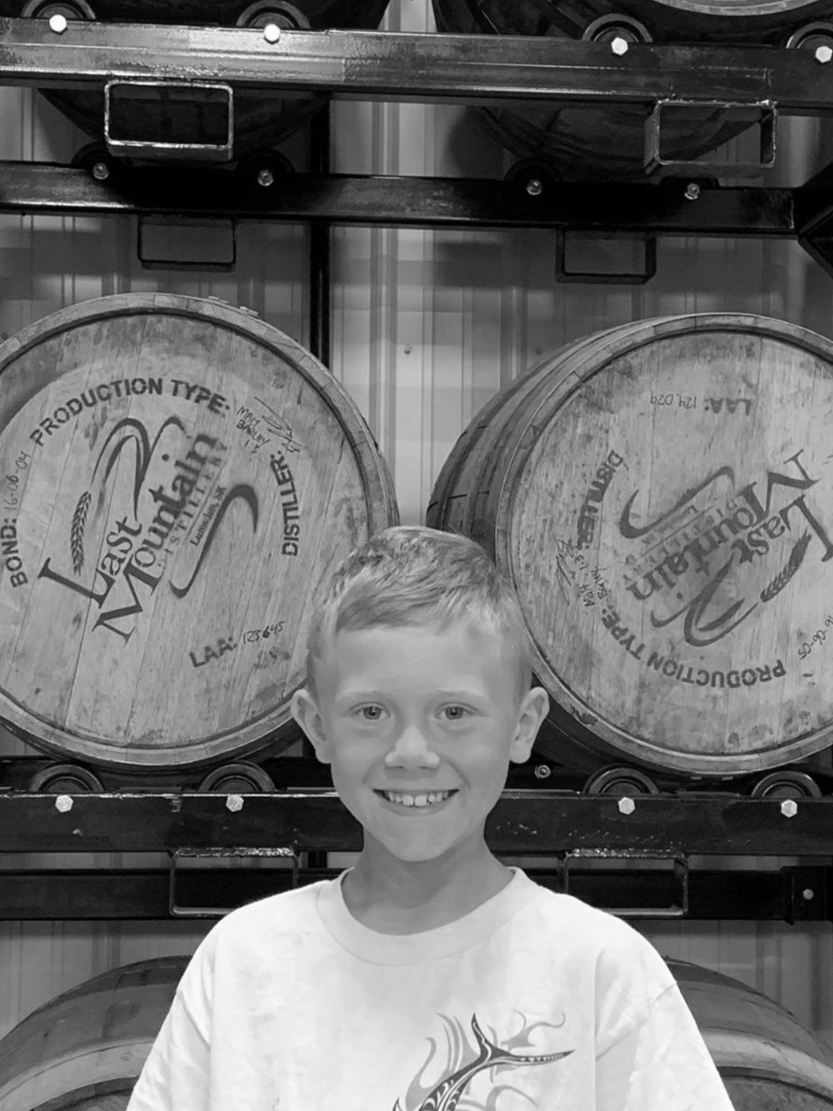 RYKER SCHMIDT   Ryker is the oldest Schmidt child. He was born the same year Colin and Meredith started the distillery in their garage and is generally referred to as LMD's twin. In the summer month's Ryker can be found on the bottling line occasionally after swim lessons.