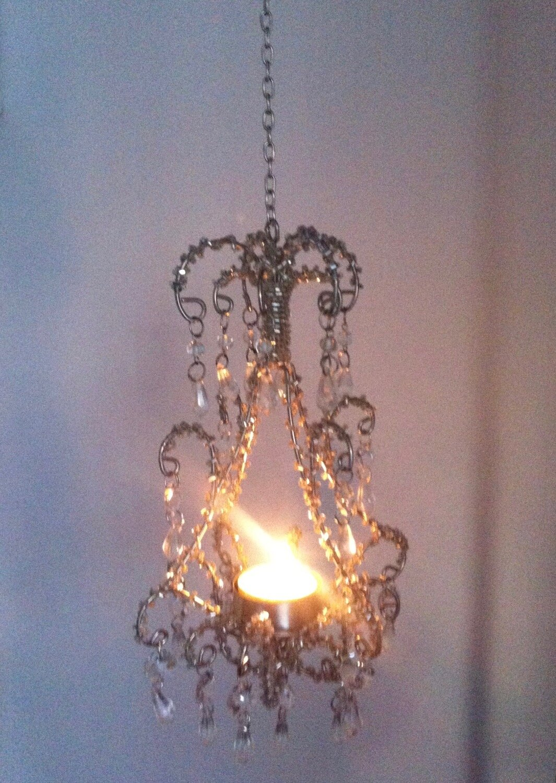 my chandelier, lit by a tealight