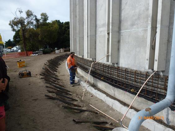 Concrete strengthening band under construction
