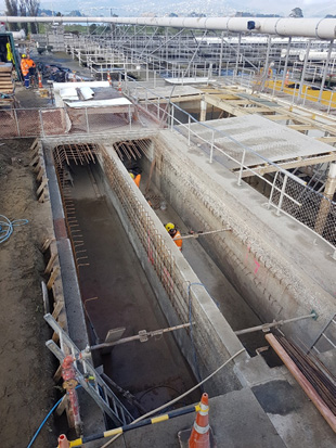 Channel section with roof removed and new reinforcing being installed