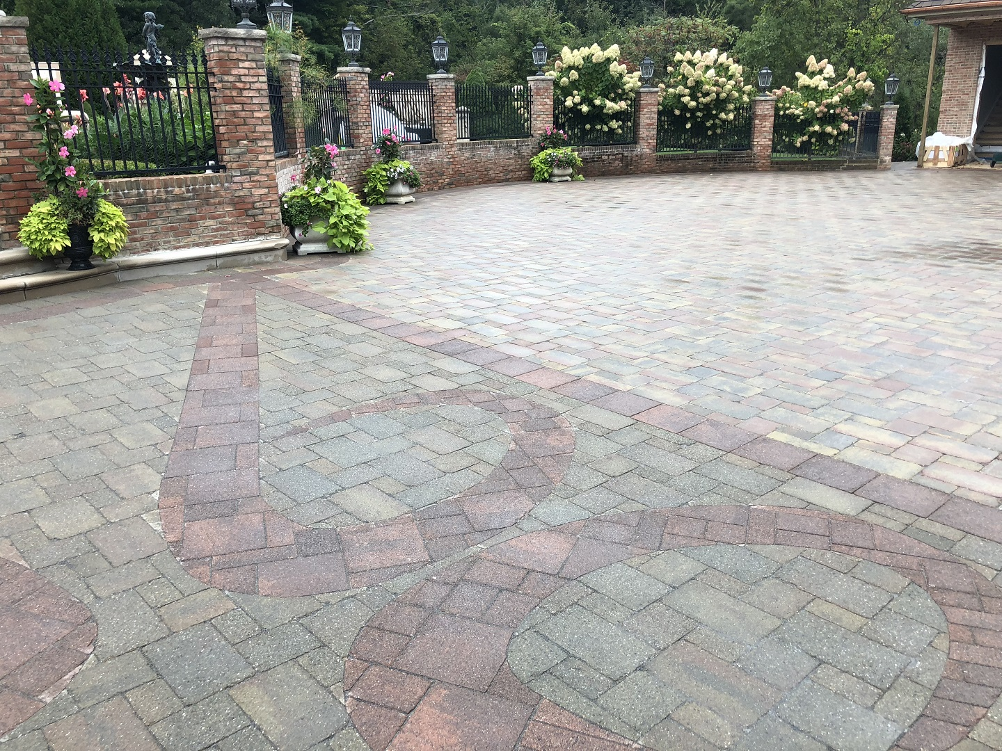 Beauitufl landscape design with driveway in Halfmoon, NY