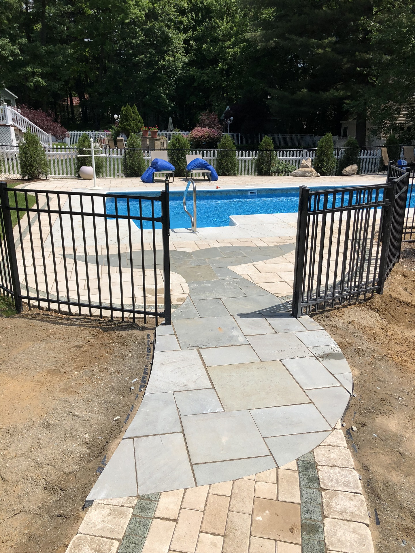 Pool deck, Unilock pavers and paver art in Halfmoon, NY