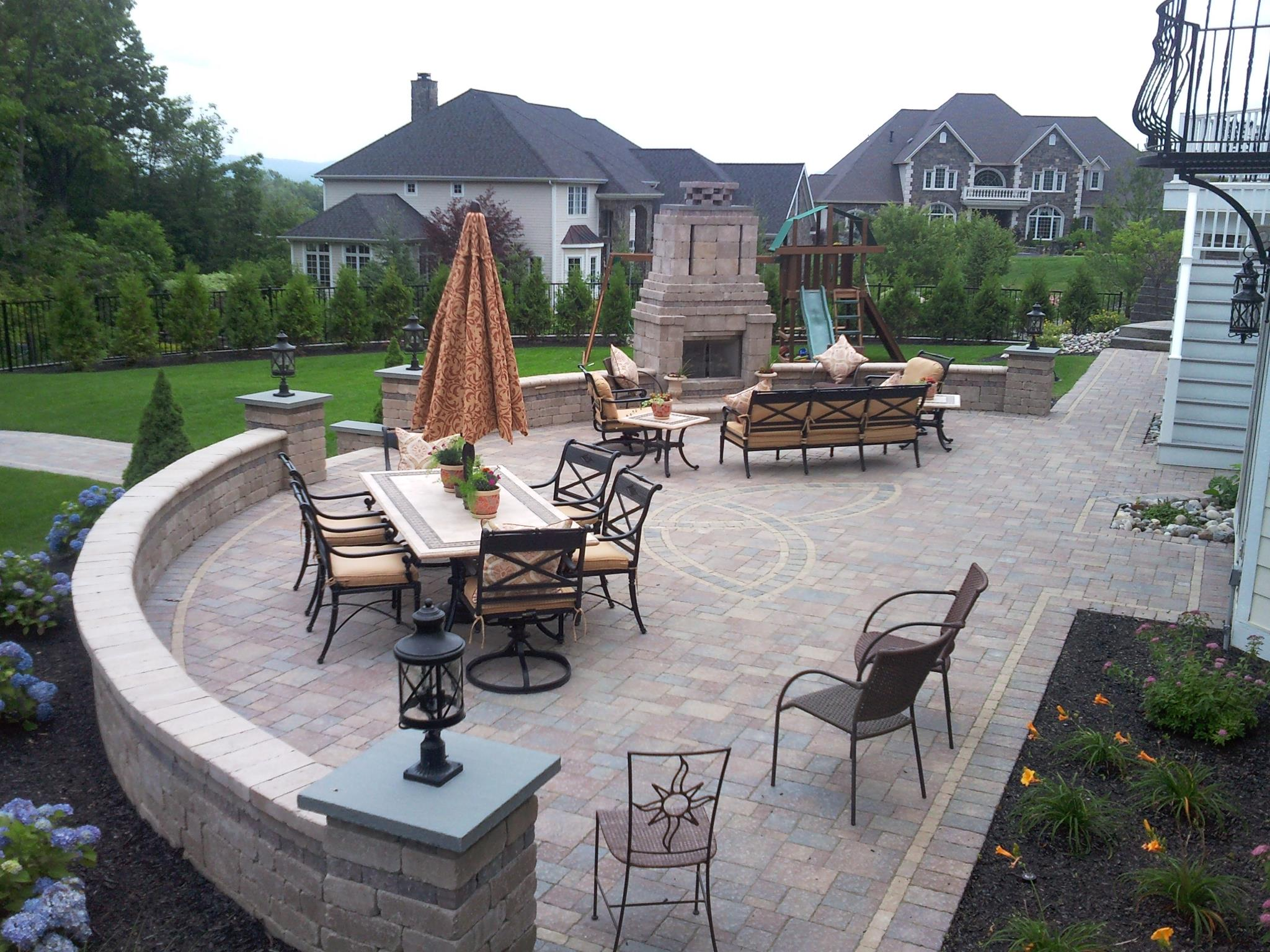 Patio with outdoor fireplace in Halfmoon, NY