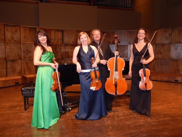 Atlantic String Quartet 2019 pic at piano.jpg