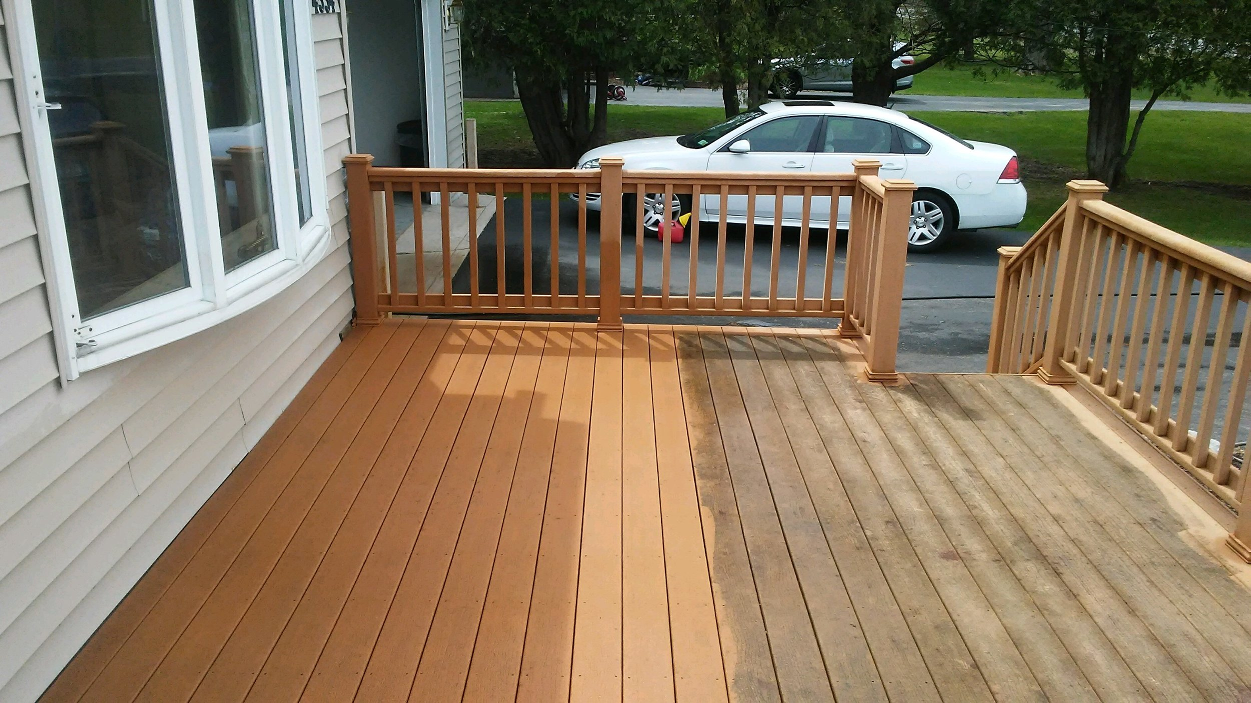 Left half of deck is cleaned. Part of it is shaded and part is in the sun.