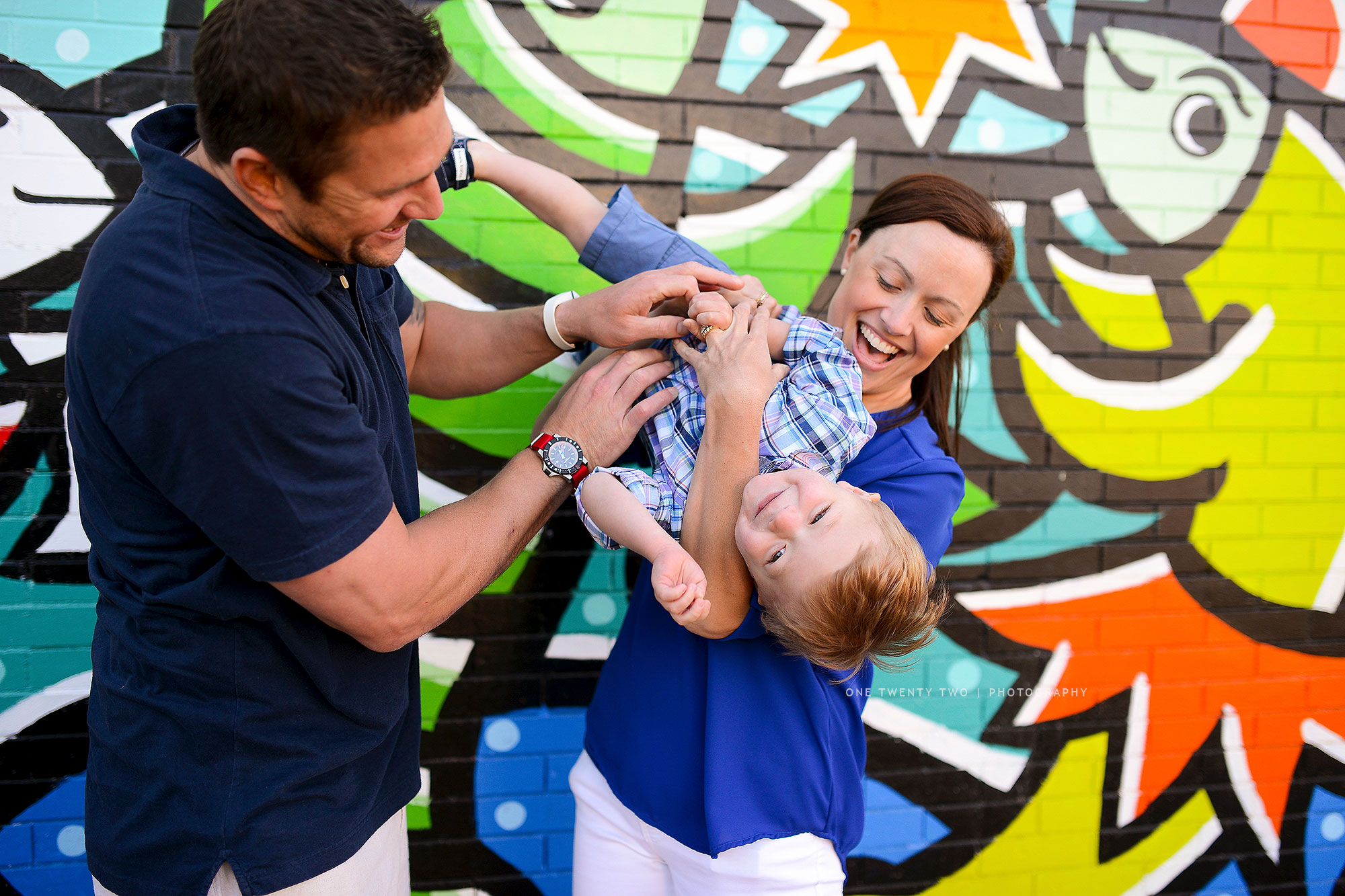 two-year-old-st-louis-portrait-in-front-of-mural-one-twenty-two-photography.jpg