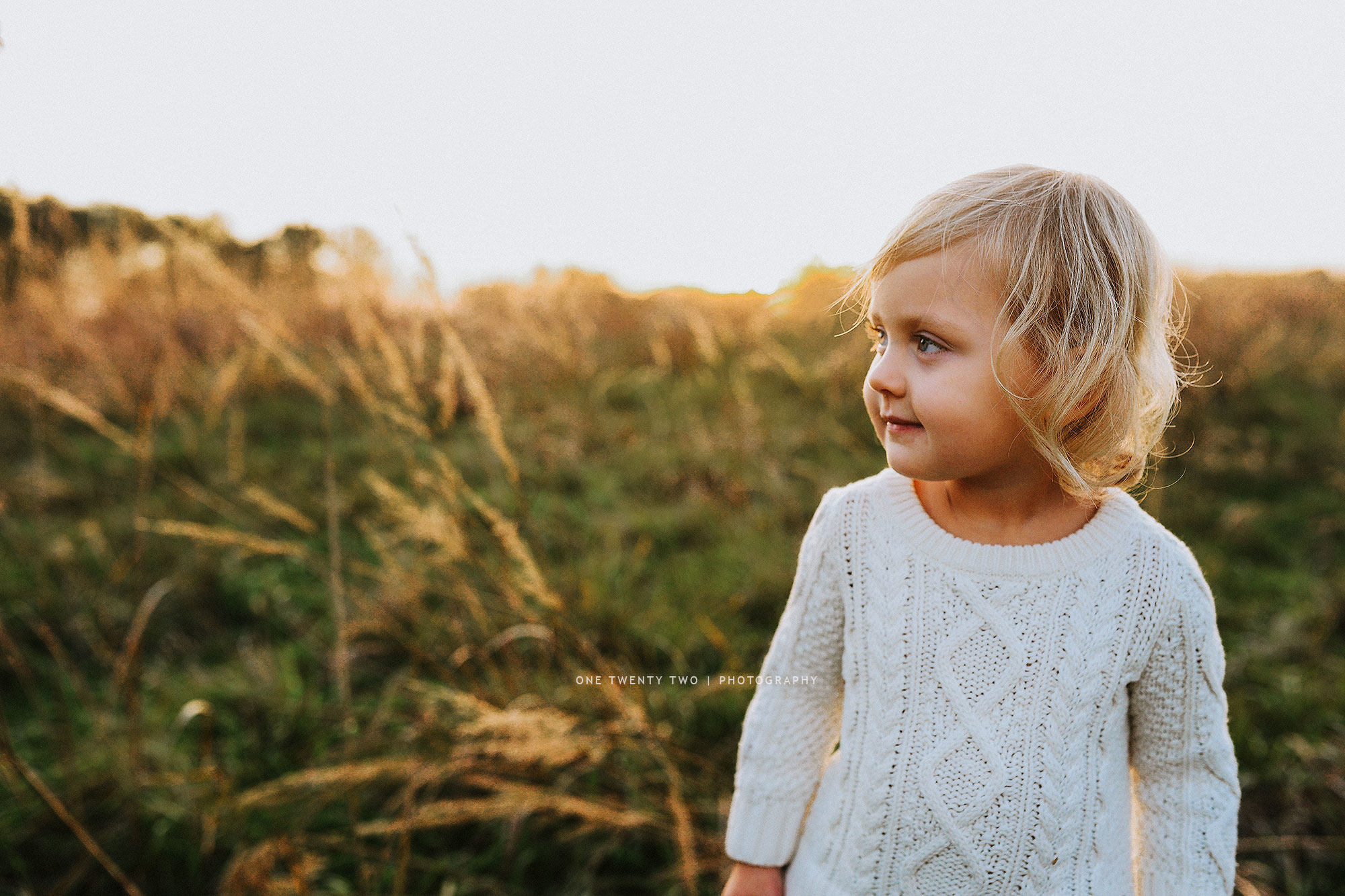 st-louis-three-year-old-in-field-at-sunset-one-twenty-two-photo.jpg