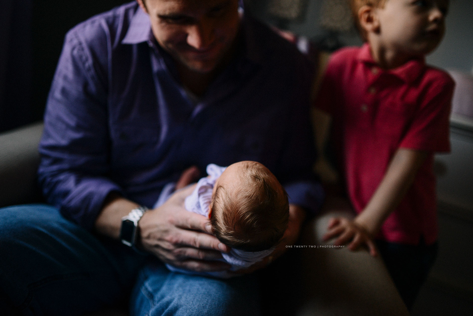 dad-son-and-newborn-pic-in-nursery-st-louis-one-twenty-two-photography.jpg