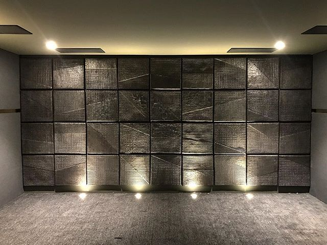 Just finished this art installation in a theatre room. Each tile starts as a steel grid and is hand dipped dozens of times in a liquid clay to form the design and texture. @innovativebuilders #theatreroom #theatre #interiordesign #midcenturymod #midmod #hospitalitydesign #tile #art #modernart #ceramics #ceramics #ceramicsculpture #brutalist #brutalistarchitecture #brutalism #brutalistdesign