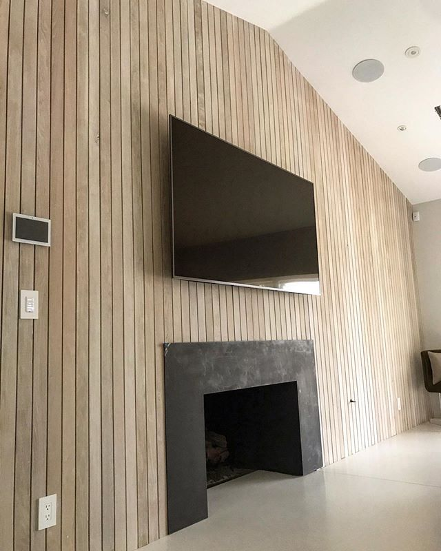 White oak accent wall we just wrapped up #innovativebuilders #interiordesign #accentwall #midcentury #midcenturymodern #whiteoak #whitewashoak #terrazzo #terrazzofloor #modern #modernarchitecture
