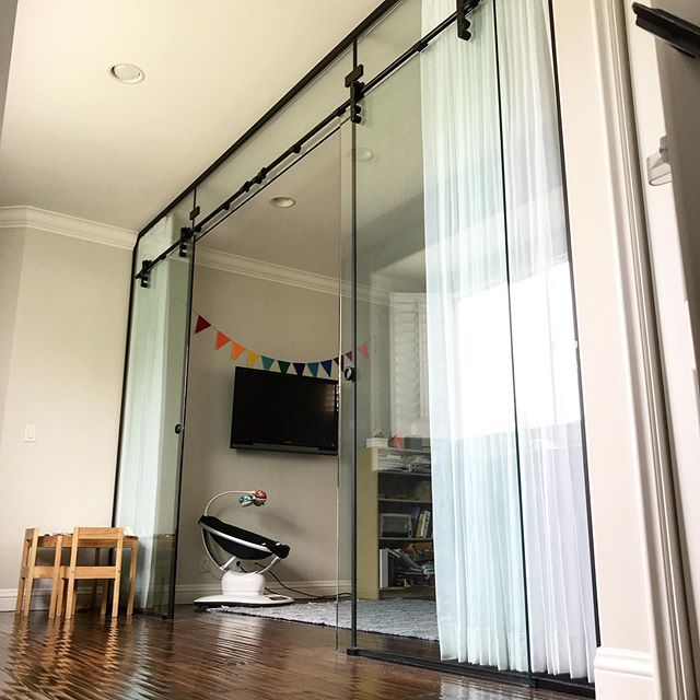 Just wrapped up this awesome glass barn door room partition. Perfect for a home office. Keeps the sound out but still let's tons of light in! #innovativebuilders #barndoor#glassbarndoor #interiordesign