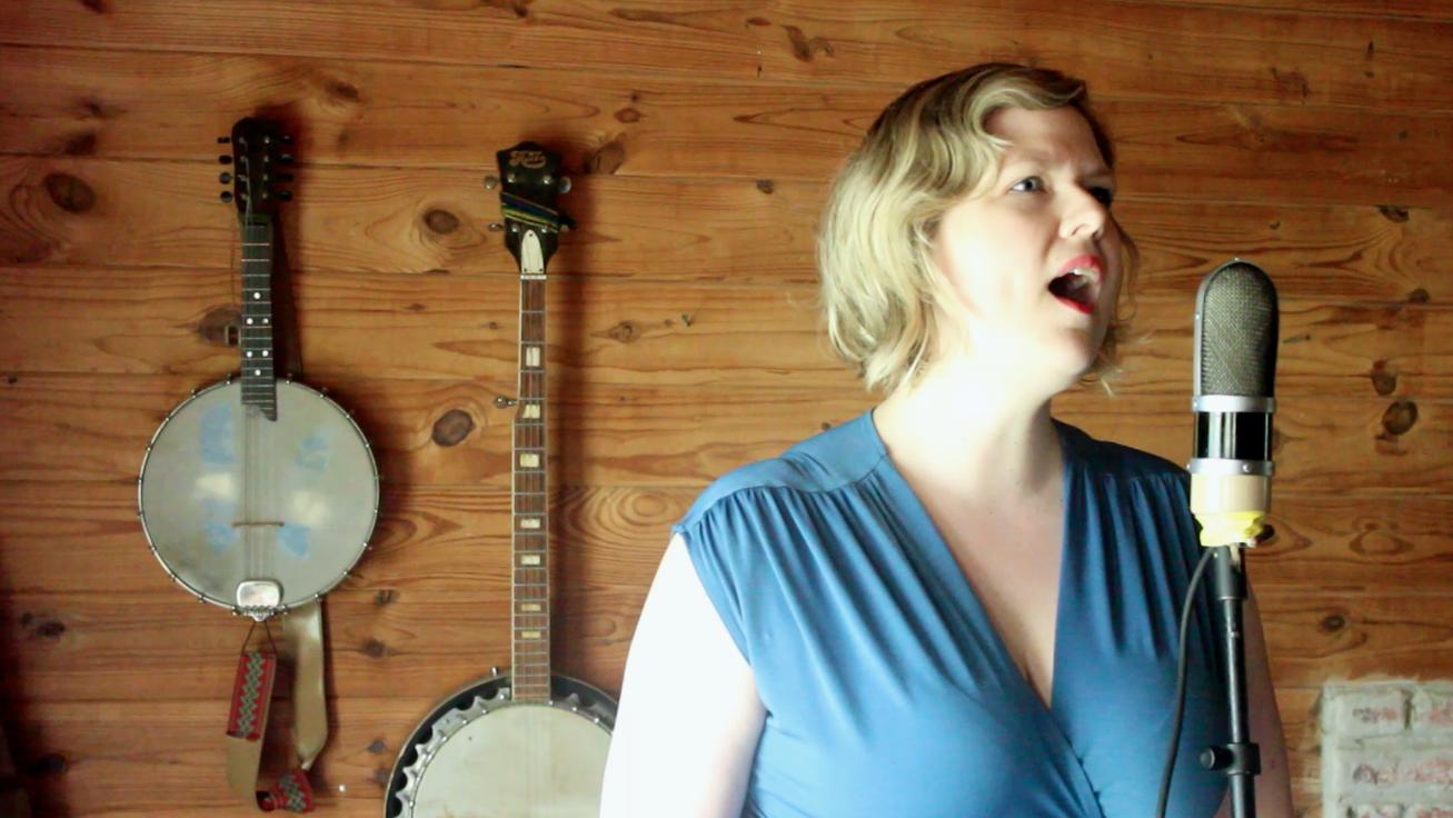 Kara Suzanne sings.png