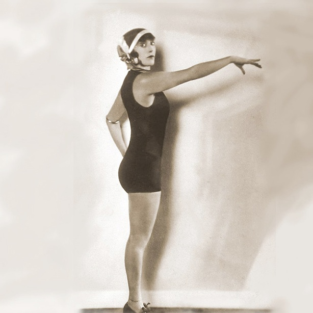 "Annette Kellerman (1887 - 1975)was a professional Olympic swimmer, vaudeville star, film actress, writer and business owner. Kellerman was famous for advocating the right of women to wear a hydrodynamic one-piece bathing suit instead of the then restrictive full pantaloons. In 1907, at the height of her popularity, Kellerman was arrested on Revere Beach in Massachusetts for indecency – she was wearing one of her fitted one-piece costumes. Her resulting line of women's swimwear, the ""Annette Kellermans,"" is the genesis of modern swimwear. - First woman to be arrested for wearing a ""too-small"" bathing suit"