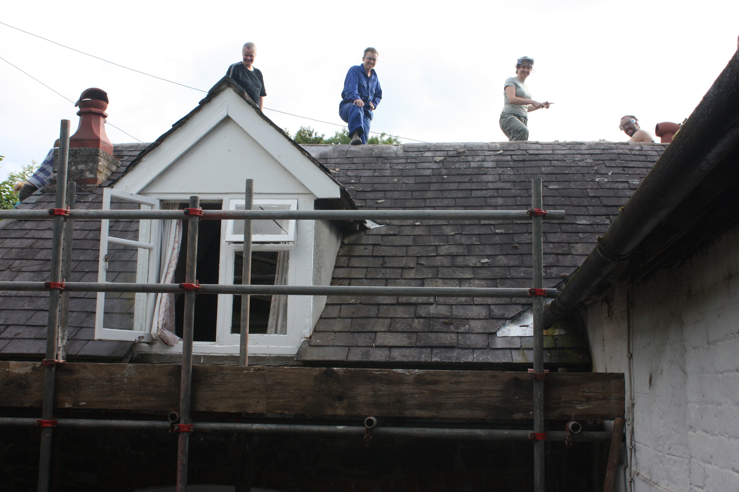 BB members working on roof repairs