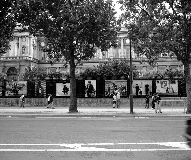 Photographs on the Palace Fence
