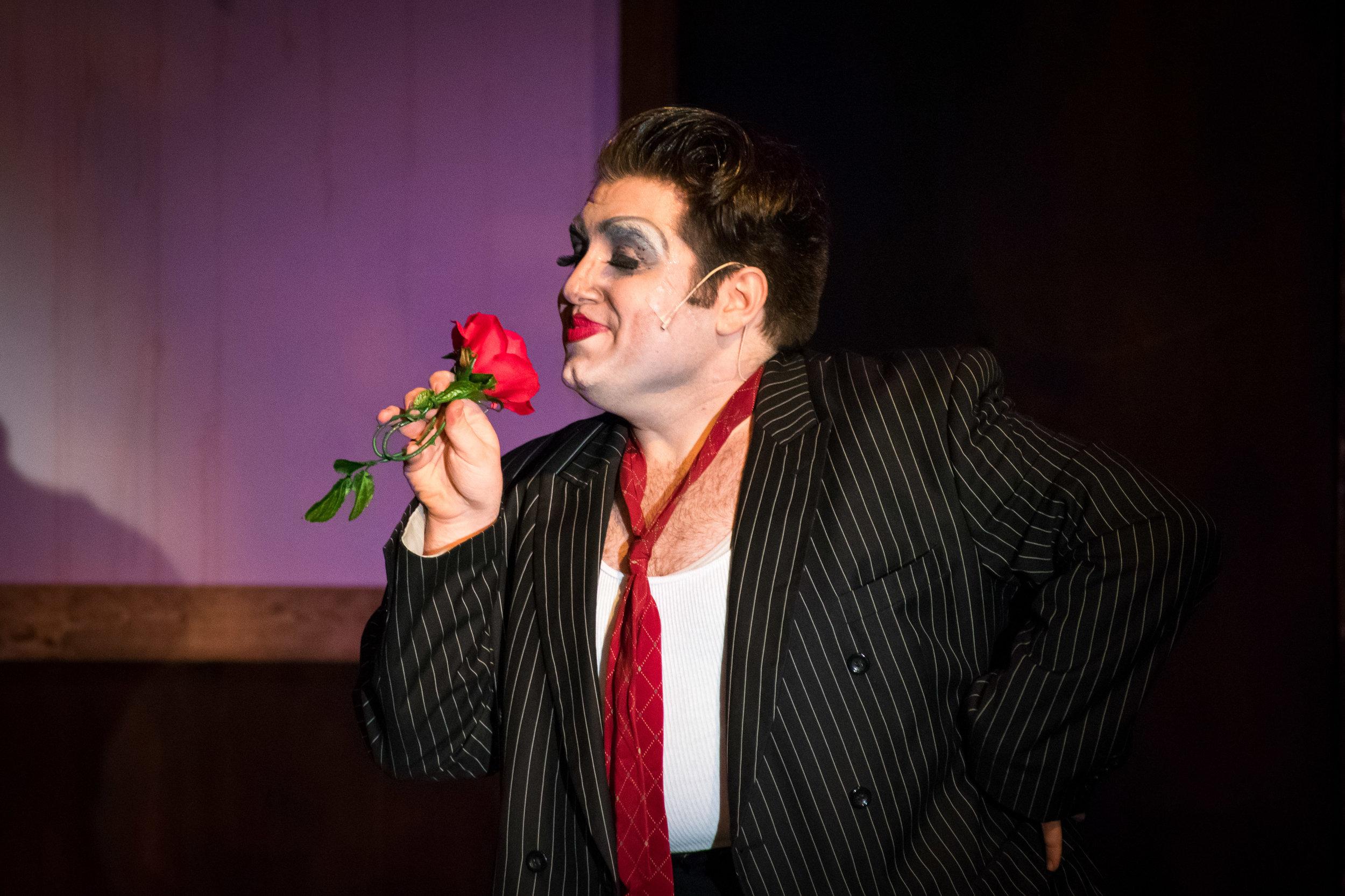 Tommy Malek as The Emcee