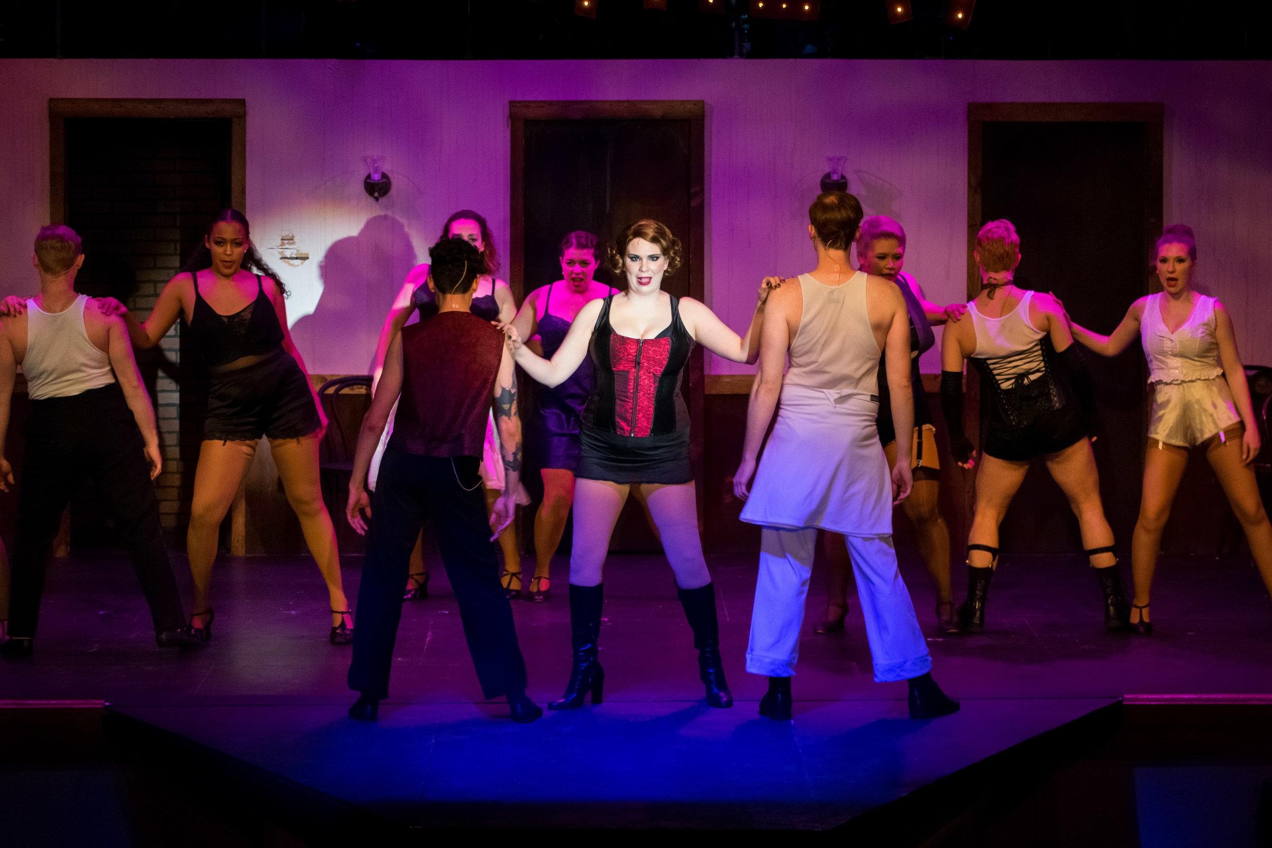Megan Mostow (C) as Sally Bowles, with the Kit Kat Dancers