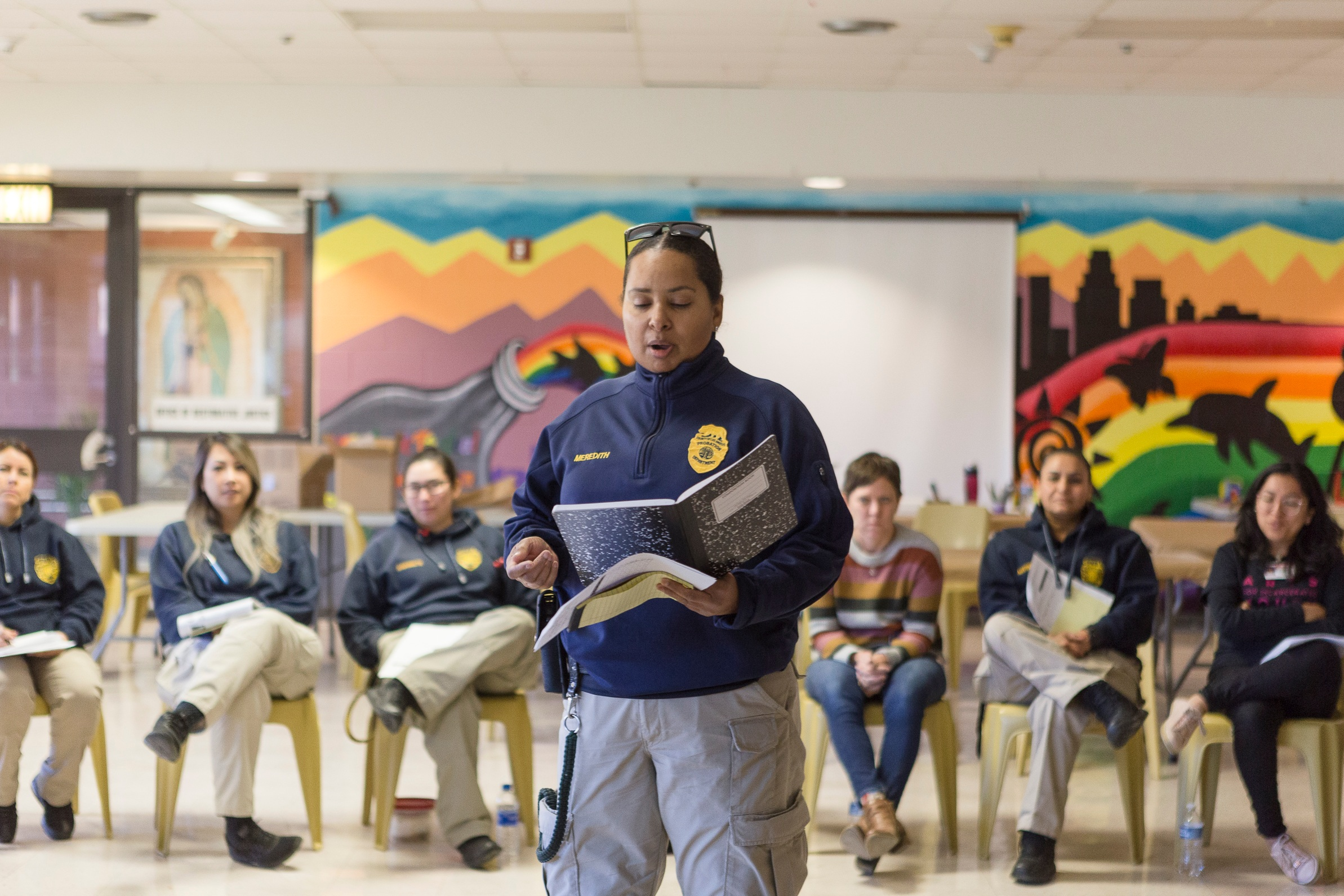 Probation staff share their writing, and drum together at our hands-on arts engagement and training of probation staff at Barry J. Nidorf.   Photo Credit: Maira Rios
