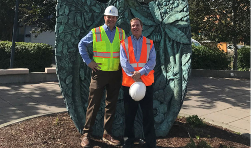 PICTURED ABOVE: Richard Obernesser, President of BDR Holdings, LLC (left) alongside Andrew Miller, Vice President of Income and Urban Properties stands next to a public art installation at Columbia Station – the iconic shovel is an appropriate placement considering the significant development taking shape on both sides of the tracks.