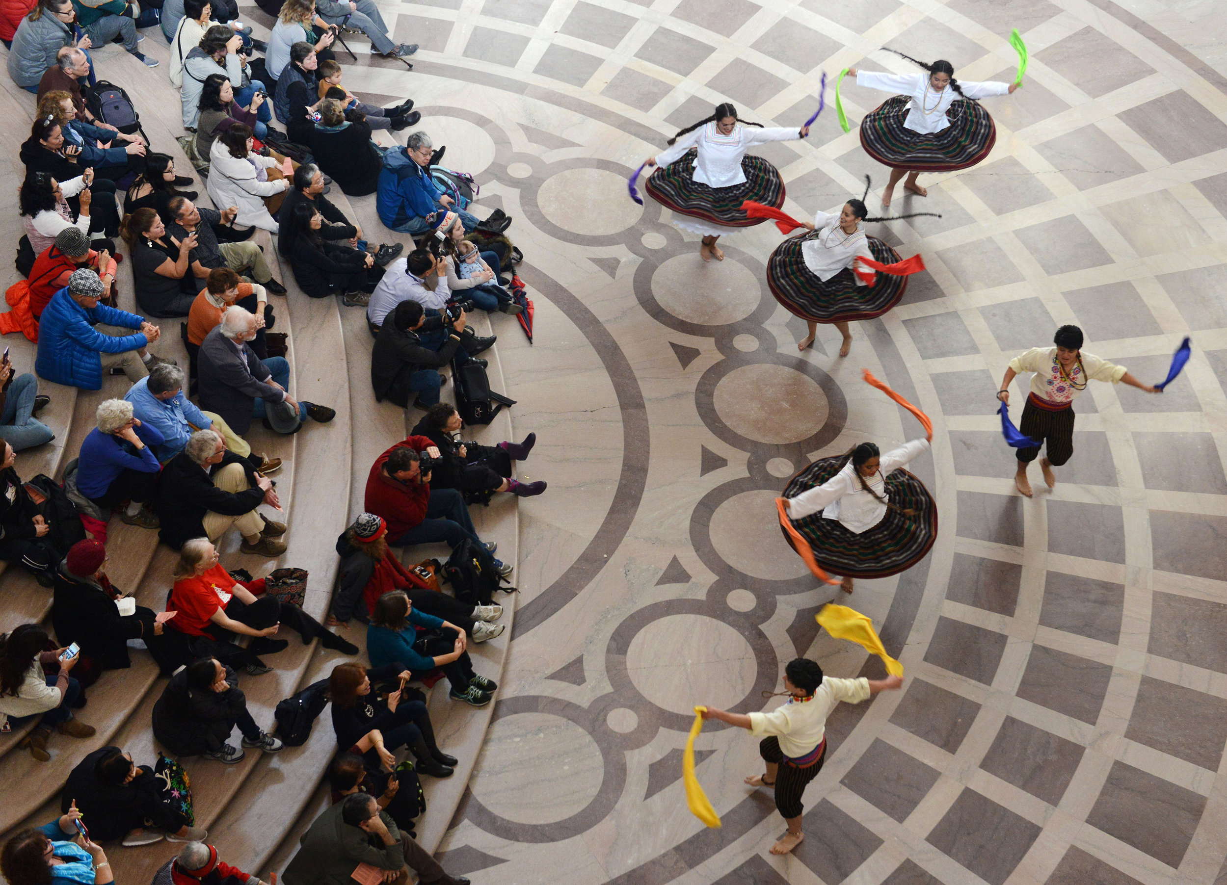 Members of Bolivia Corazón de América perform for an audience during a free lunchtime noon concert as a part of the Rotunda Dance Series in City Hall in San Francisco, Ca. on Friday, December 9, 2016. Photo by David Andrews