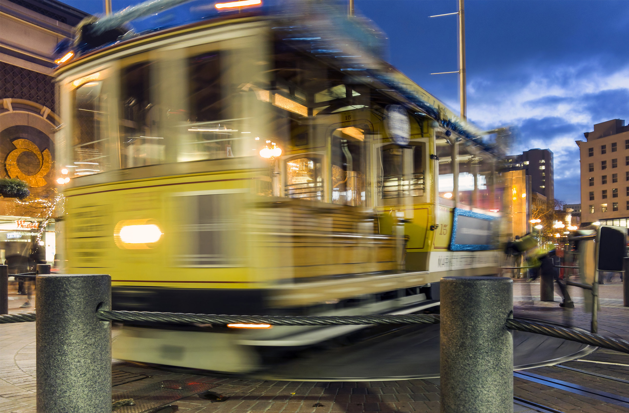 Operators spin one of the famed San Francisco cable cars on its rotating pallet on the corner of Market and Market Streets on Thursday, January 25, 2018 in San Francisco, Ca. The long exposure was shot with a Light L16. Photo by David Andrews.