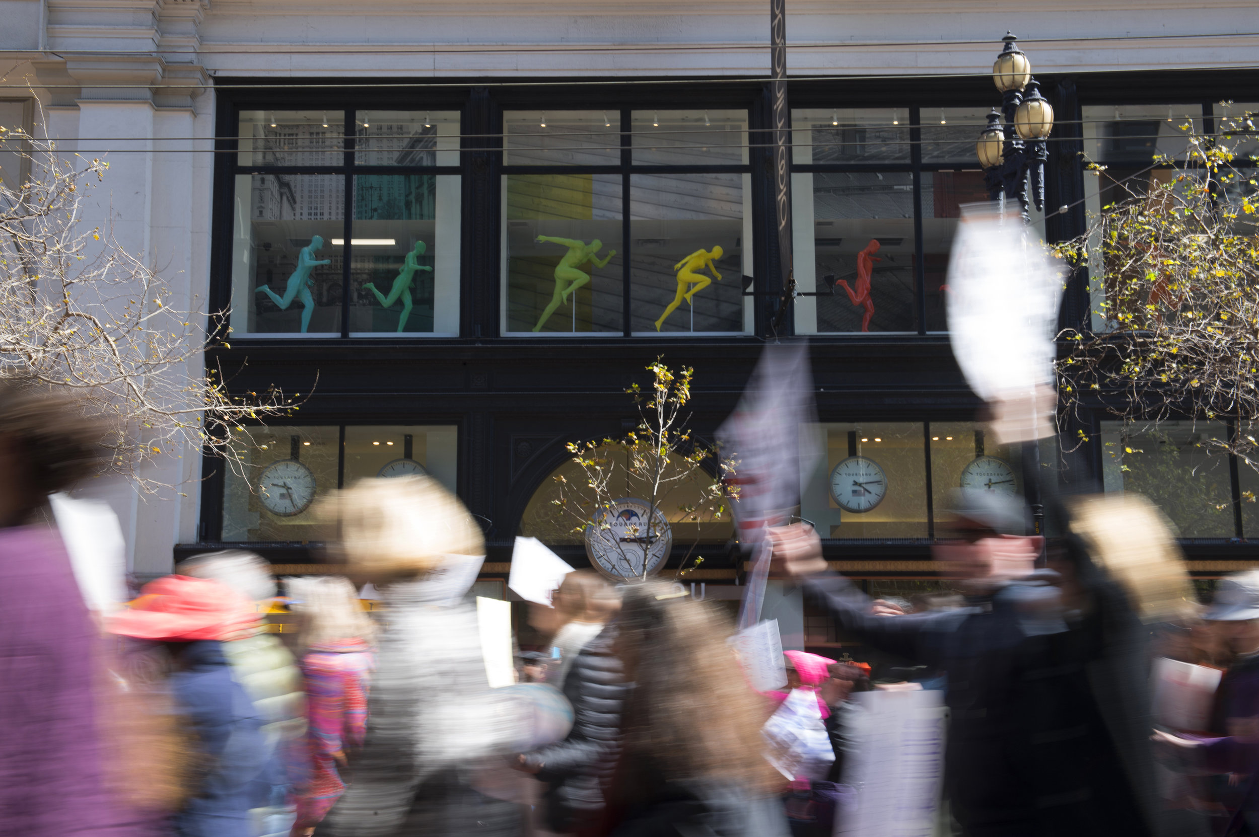 'March for our Lives' protesters march down Market Street past Adidas Store mannequins in San Francisco, Ca. on Saturday, March 24, 2018. The gathering in San Francisco was one of many marches nationwide to advocate for voter registration in an effort to vote to curb U.S. gun laws. Photo by David Andrews.