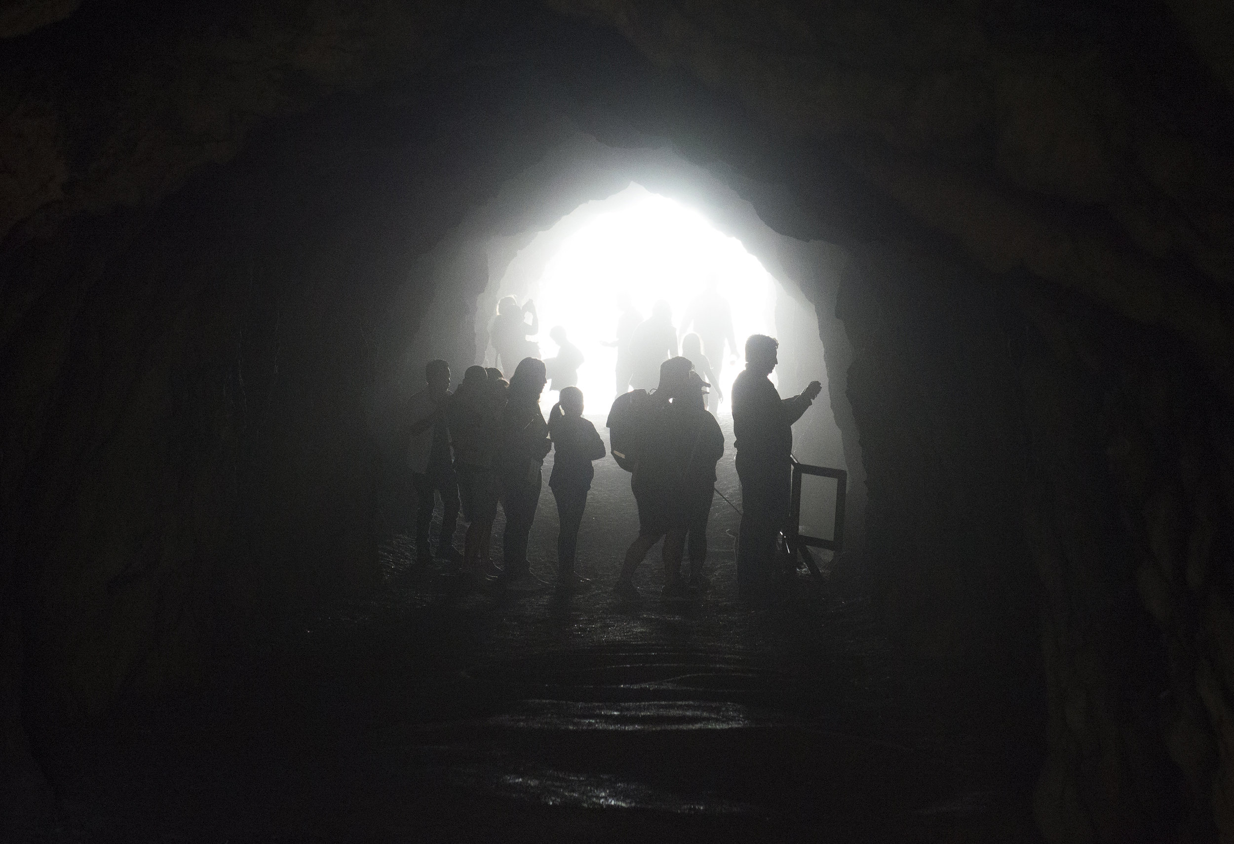 Visitors explore the misty Sutro Baths cave at Land's End in San Francisco, Ca. on Friday, November 24, 2017. Photo by David Andrews.