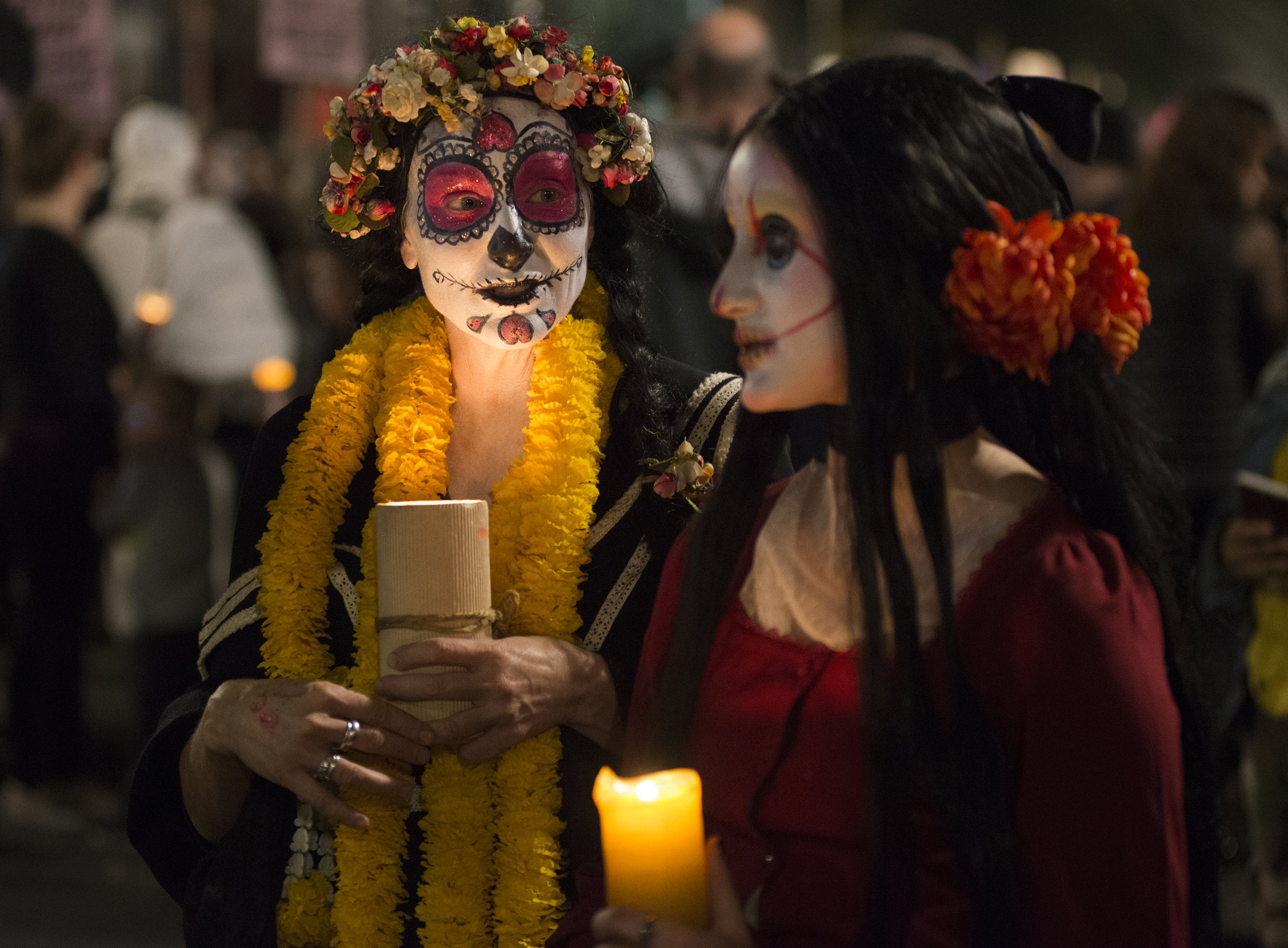 Wendy Testu, left, and Lolita Testu hold candles during the annual Dia De los Muertos procession in the Mission district in San Francisco, Ca. on Friday, November 2, 2018. Photo by David Andrews.  See more here .