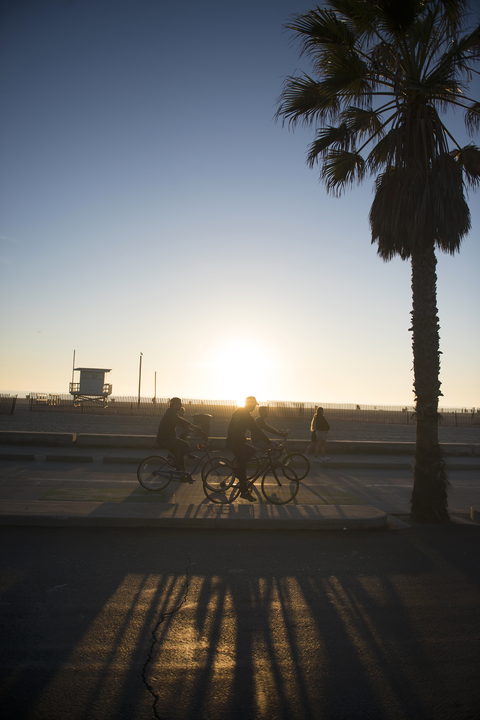 Bikers ride along the bike path between Venice Beach and the Santa Monica Beach pier in Los Angeles, Ca. on Thursday, December 28, 2017. Temperatures in the 70's made for optimal beach weather to close out the year along the Southern California coast. Photo by David Andrews.