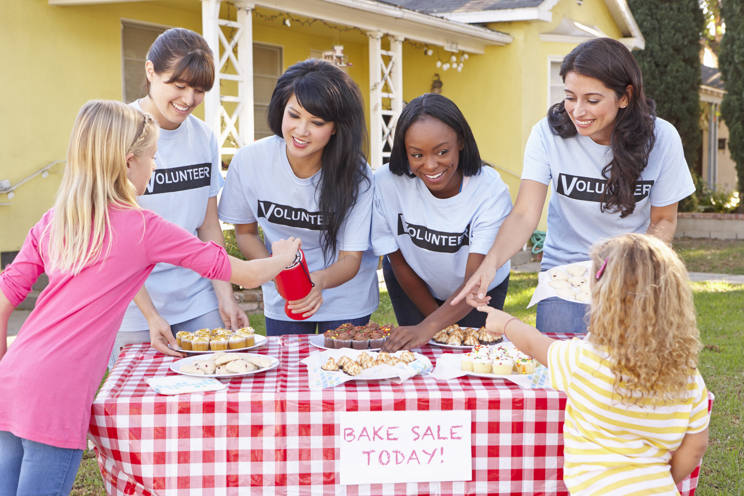 women-and-children-running-charity-bake-sale-PN8X7UJ.jpg