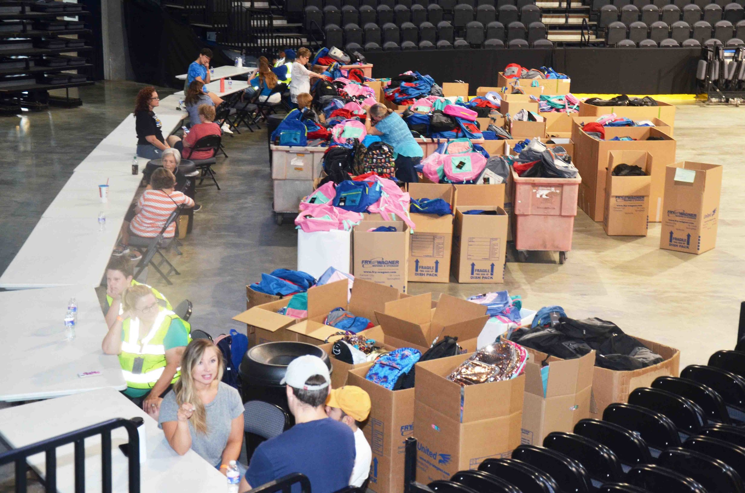 Photo Credentials: Velda Cook with Photographic Arts, LLC. Pictured is about 3,000 backpacks filled with supplies.