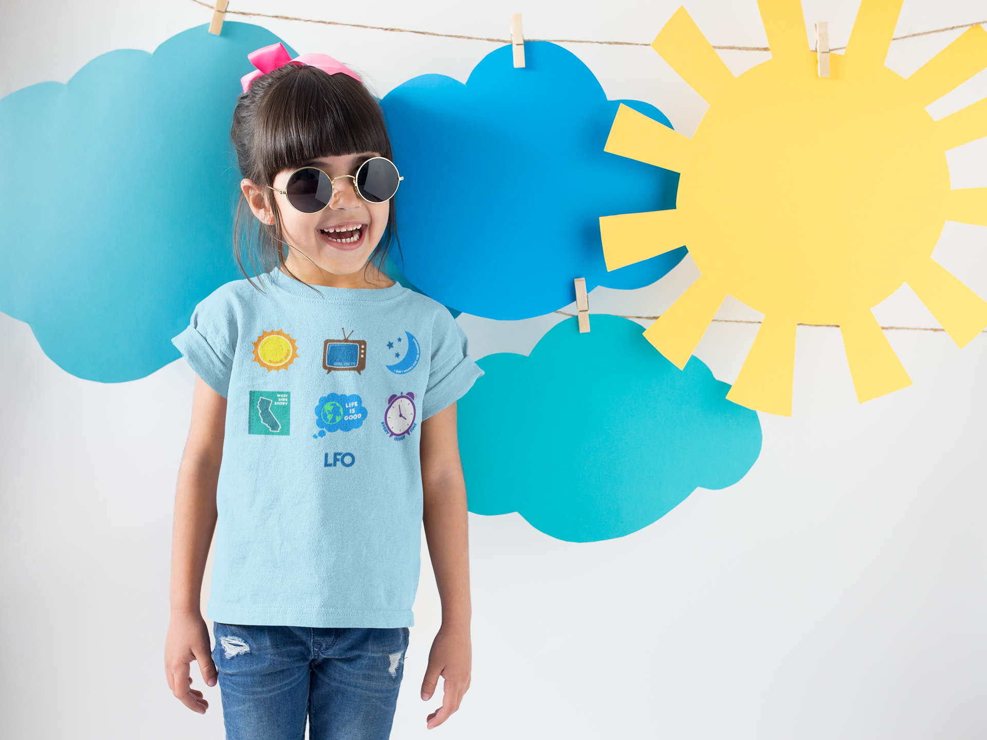 smiling-girl-wearing-a-round-neck-tshirt-template-near-cardboard-sun-and-clouds-a19480.png