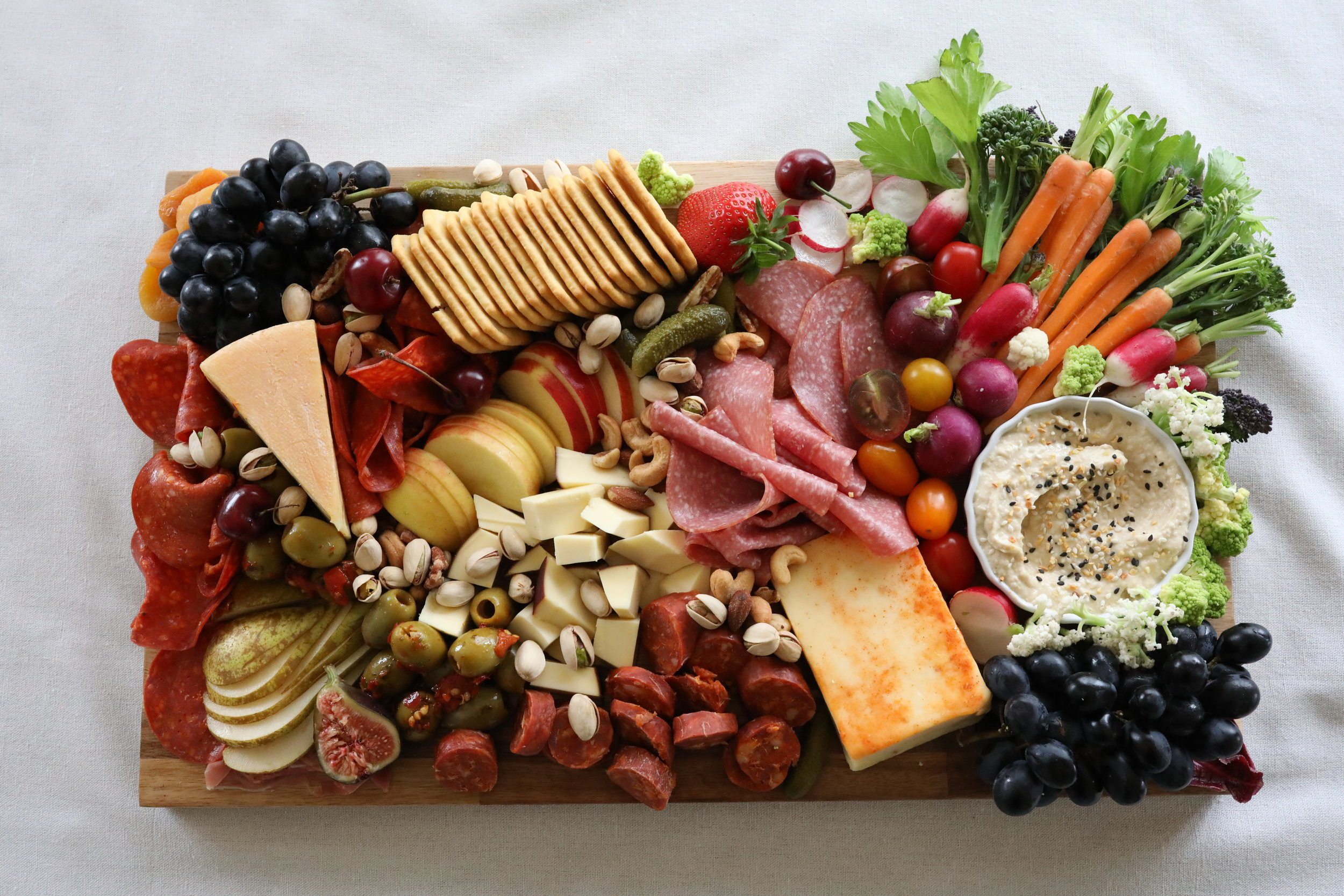 A LITTLE OF EVERYTHING BOARD WITH HUMMUS